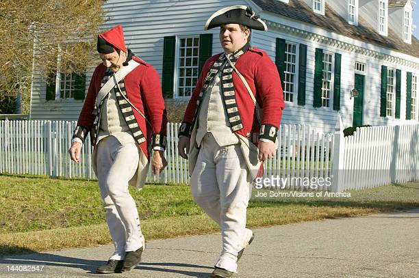 British soldiers walk in front of the Digges House built in 1775 in Yorktown Virginia First owner Dudley Digges' house now resides in the Colonial...