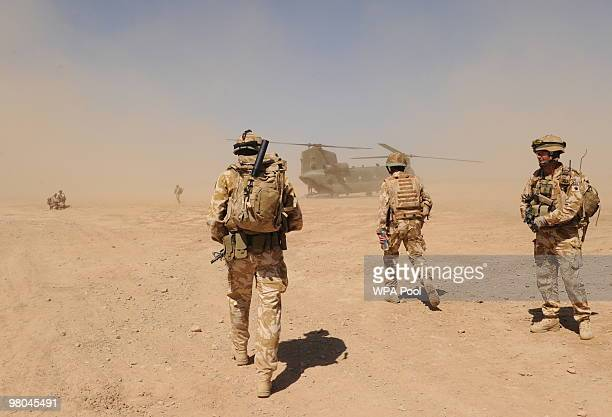 British soldiers walk to a military helicoopter near the Pimon military camp on March 25 2010 in Nade Ali Afghanistan Prince Charles arrived in...