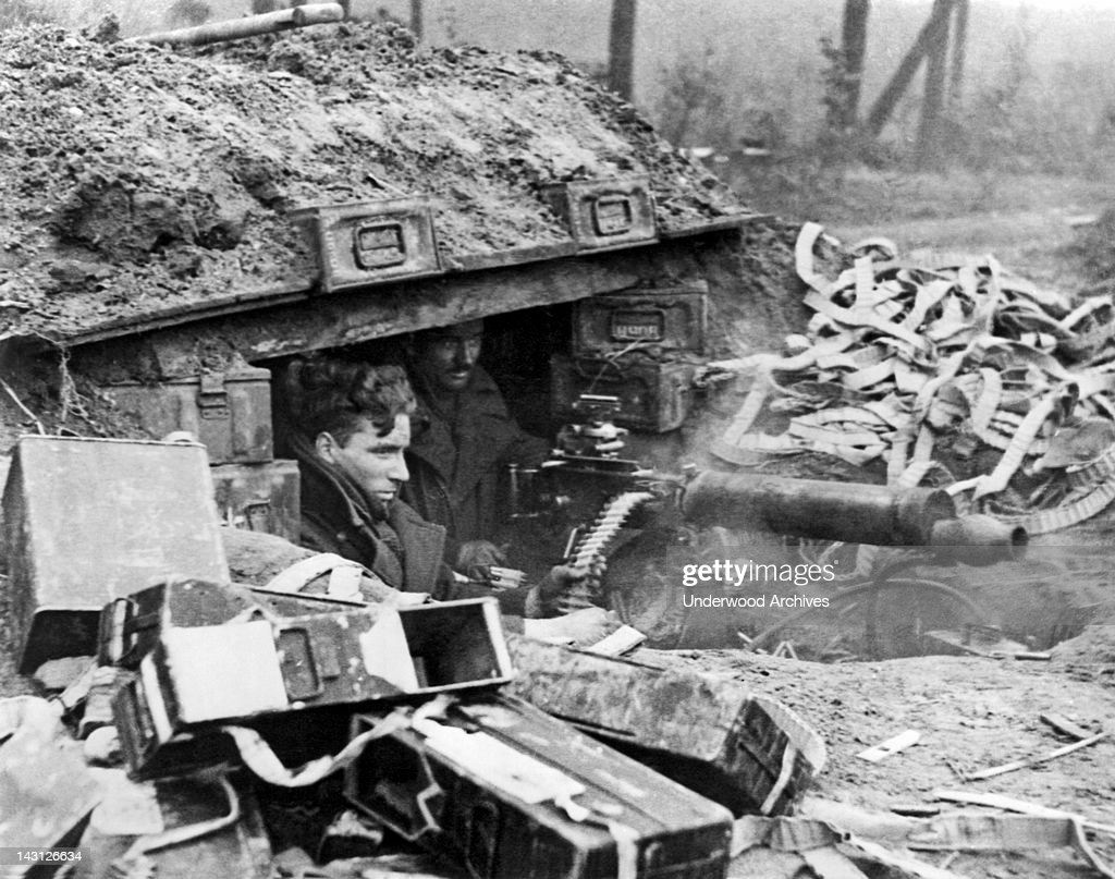 British soldiers with a Vickers machine gun give support to advancing infantrymen during an offensive Nijmegen Netherlands February 8 1945