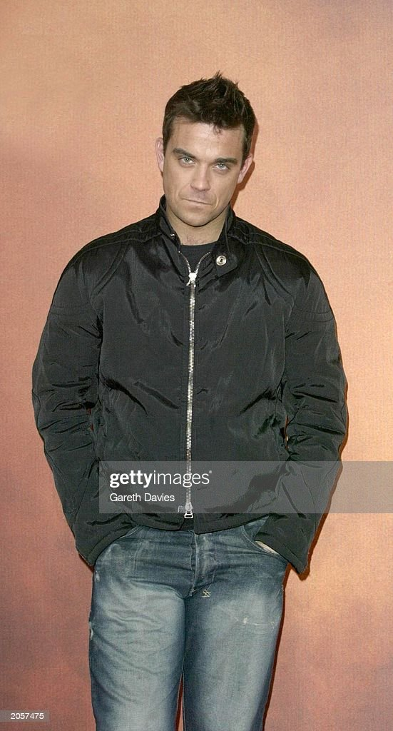 British solo artist Robbie Williams announces the dates of his 2003 European Tour from the British Embassy in Berlin, Germany on November 19, 2002.