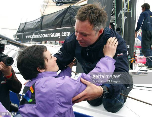 British solo sailor Jonny Malbon receives a farewell kiss from his former boss Dame Ellen MacArthur just before the start of the prestigious Vendee...