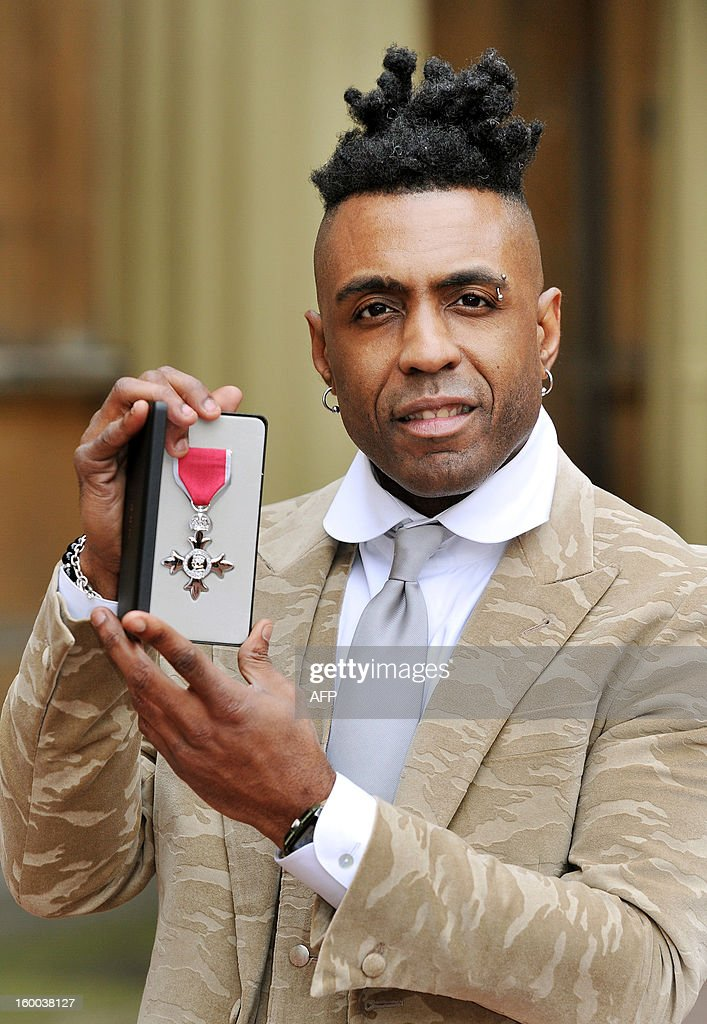 British soul singer Omar Lyefook holds his Member of the British Empire (MBE) medal after it was presented to him by the Prince of Wales during the Investiture ceremony at Buckingham Palace in central London on January 25, 2013.