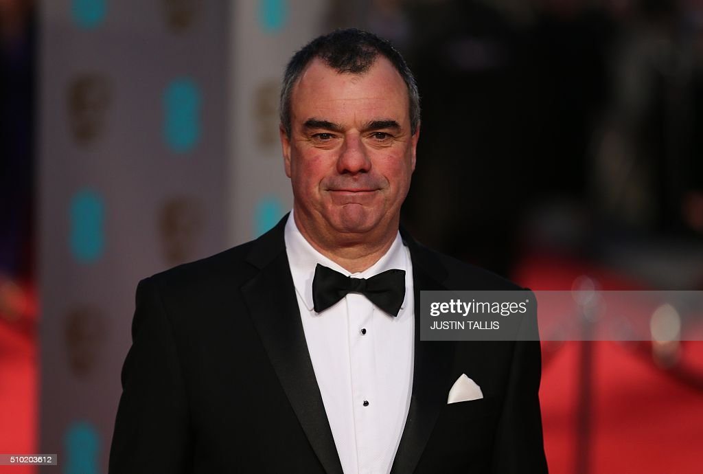 British special effects coordinator Chris Corbould poses on arrival for the BAFTA British Academy Film Awards at the Royal Opera House in London on February 14, 2016. TALLIS