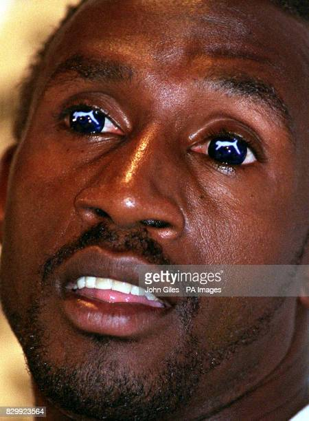 British sprinter Linford Christie unveils his Puma contact lenses at a news conference in Atlanta * 4/8/99 It has been confirmed that Christie failed...