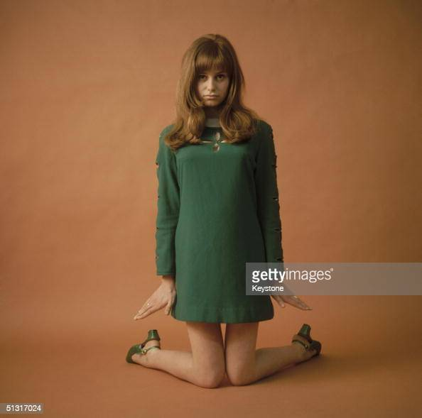 British stage and film actress Susan George in a minidress with matching green shoes
