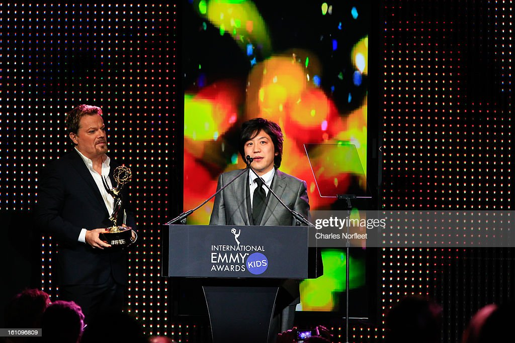 British stand-up comedian Eddie Izzard (L) presents the Kids:Series Emmy Award to Japanese director Hiroki Hayashi (R) for 'Junior High School Diaries: Harmony of Two' during The Inaugural International Emmy Kids Awards at The Lighthouse at Chelsea Piers on February 8, 2013 in New York City.