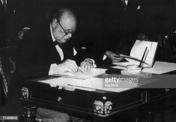 British statesman Winston Churchill puts pen to paper 1936