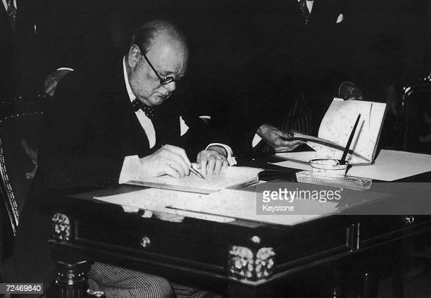 British statesman Winston Churchill puts pen to paper 1936