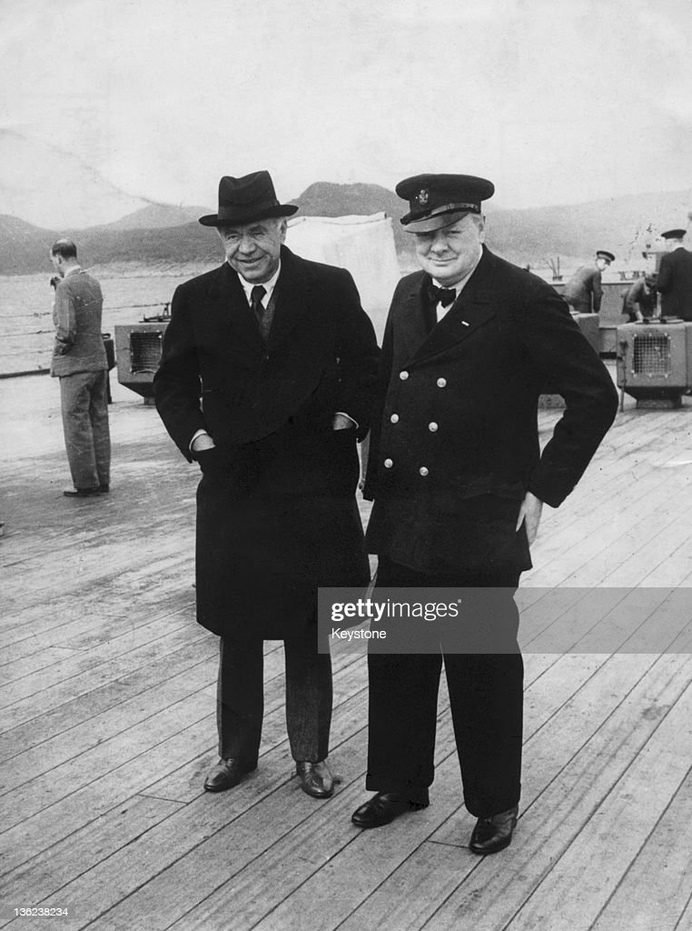 British statesman Winston Churchill (1874 - 1965, right) with Canadian-British press magnate Max Aitken, Lord Beaverbrook (1879 - 1964), on board HMS Prince of Wales during the Atlantic Conference with President Roosevelt, Newfoundland, August 1941.