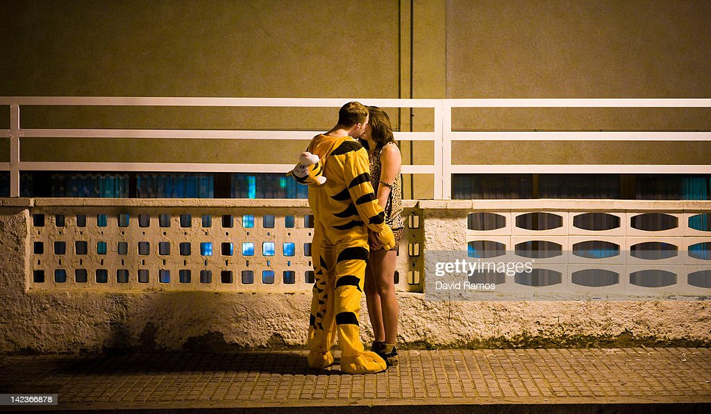 A British student dressed up as a tiger kisses another student during the second night of parties during the SalouFest on April 2, 2012 in Salou, Spain. Saloufest is a university sports tour attended by thousands of British students taking part in a variety of competitions and parties over the Easter period in the Catalan village of Salou.