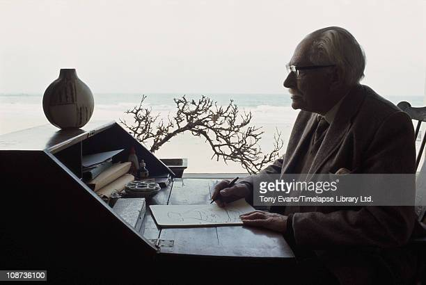 British studio potter Bernard Leach at his desk in St Ives with pot that featured in Royal Mail commemorative stamp 1974