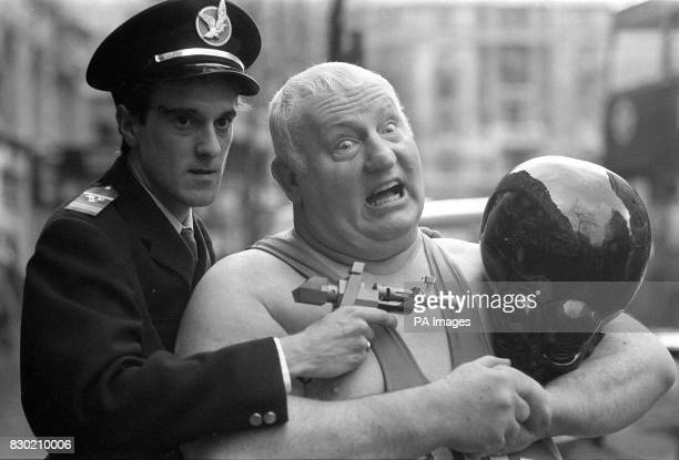 British super heavyweight wrestler 'Big Daddy' clamps an armlock on Meken a fearsome invader from Venus watched by 'Dan Dare' at the launch by IPC in...