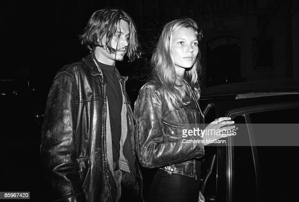 British supermodel Kate Moss and American actor Johnny Depp leaving a party for John Waters' film 'Serial Mom' in 1994 in New York City New York