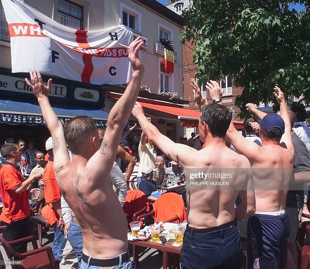 British supporters chant and drink beer 17 June 2000 a few hours before the Euro 2000 first round match between England and Germany in Charleroi In...
