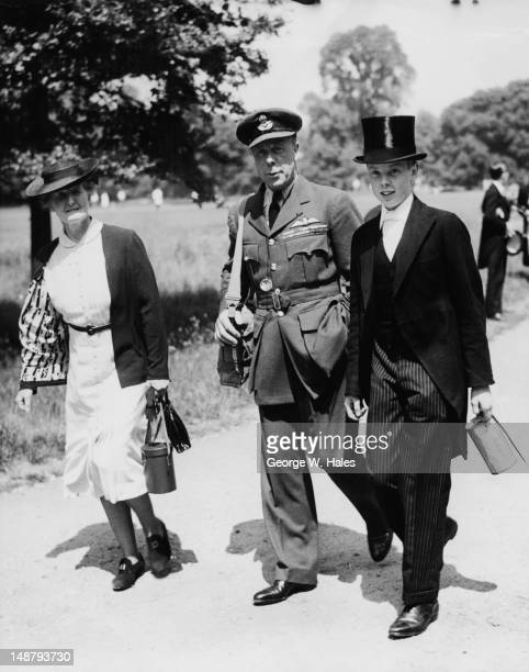 British surgeon rugby player and courtier Louis Greig a Wing Commander in the Royal Air Force with his wife Phyllis and their son Carron Greig during...