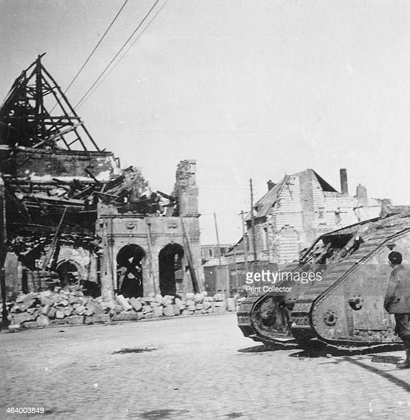 British tank in front of ruined buildings Peronne France World War I c1916c1918 Stereoscopic card detail