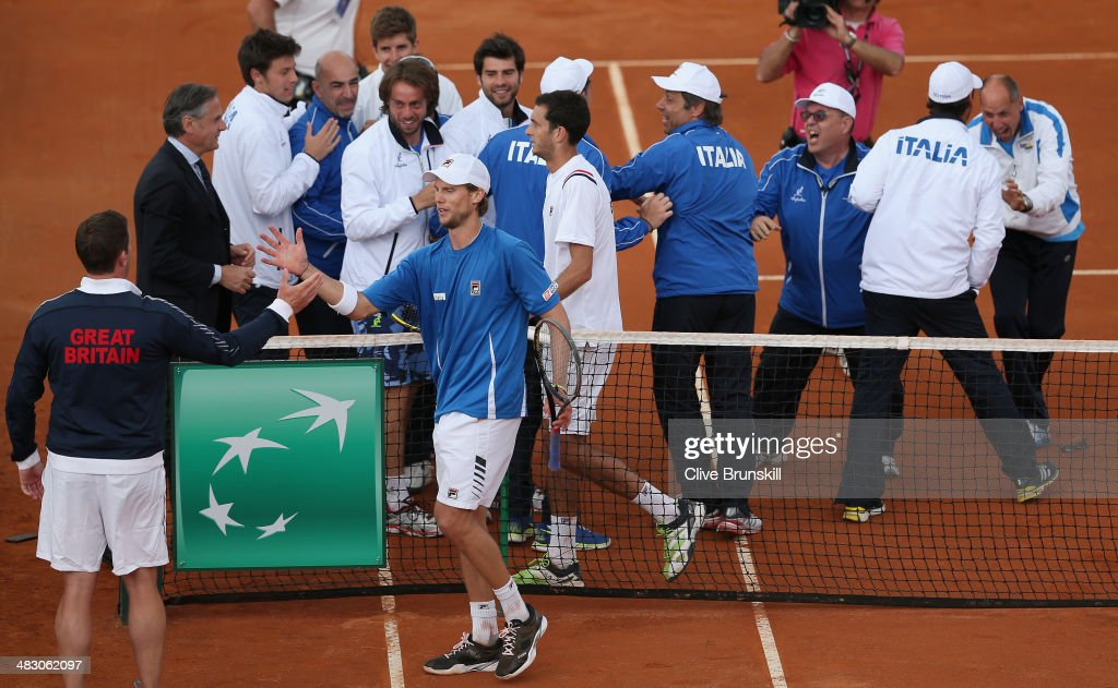 British team captain Leon Smith shakes hands and congratulates Andreas Seppi of Italy after winning the fifth and decisive rubber against James Ward of Great Britain during day three of the Davis Cup World Group Quarter Final match between Italy and Great Britain at Tennis Club Napoli on April 6, 2014 in Naples, Italy.