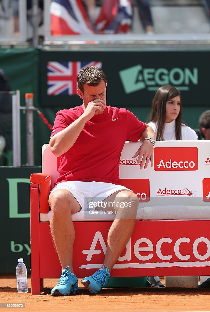 British team captain Leon Smith shows his emotions as he watches Andy Murray of Great Britain during his straight sets defeat in the fourth rubber by Fabio Fognini of Italy during day three of the Davis Cup World Group Quarter Final match between Italy and Great Britain at Tennis Club Napoli on April 6, 2014 in Naples, Italy.