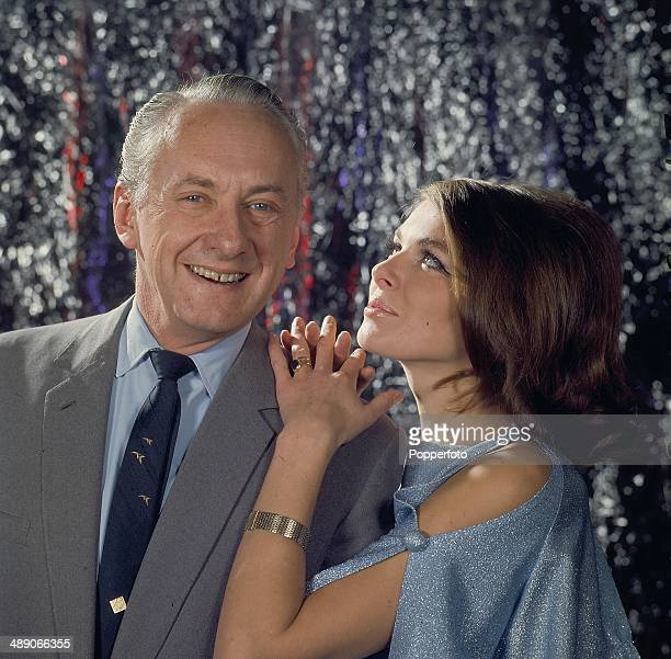British television game show host Hughie Green posed with hostess Julie Ege from the television quiz show 'Double Your Money' in 1968