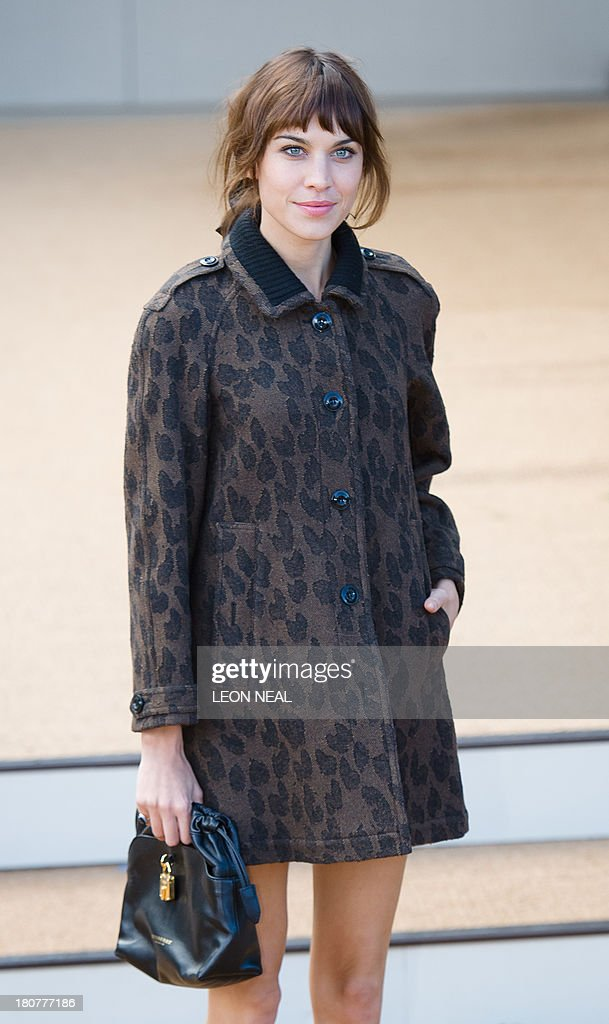 British television presenter Alexa Chung arrives to attend the Burberry Prorsum show at the 2014 Spring-Summer London Fashion Week at Kensington Gardens in London on September 16, 2013 , England. AFP PHOTO / LEON NEAL