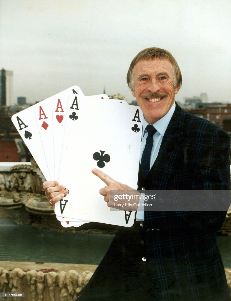 British television presenter Bruce Forsyth holding four giant aces in a promotional shot for the tv series 'Play Your Cards Right', 10th December 1993.