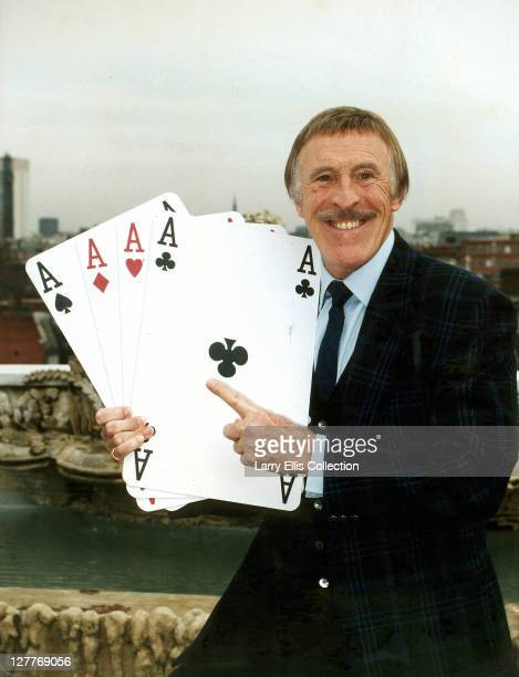 British television presenter Bruce Forsyth holding four giant aces in a promotional shot for the tv series 'Play Your Cards Right' 10th December 1993