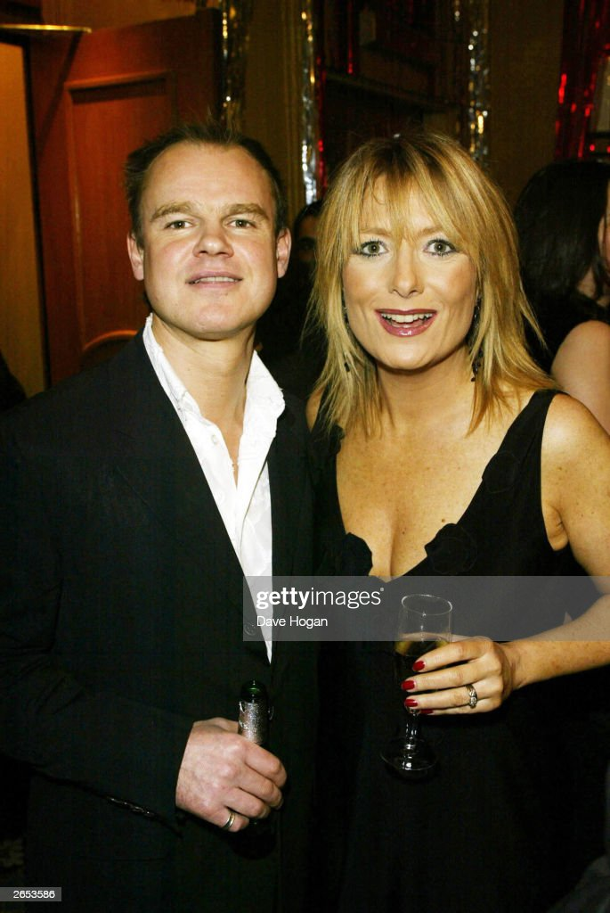 British television presenter Gaby Roslin and her husband Colin Peel attend the 'Chicago' film party at the Cafe Royal on December 8, 2002 in London.