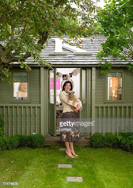 British television presenter Kirstie Allsopp with her pet dog Foxy at home in West London on 2nd June 2005
