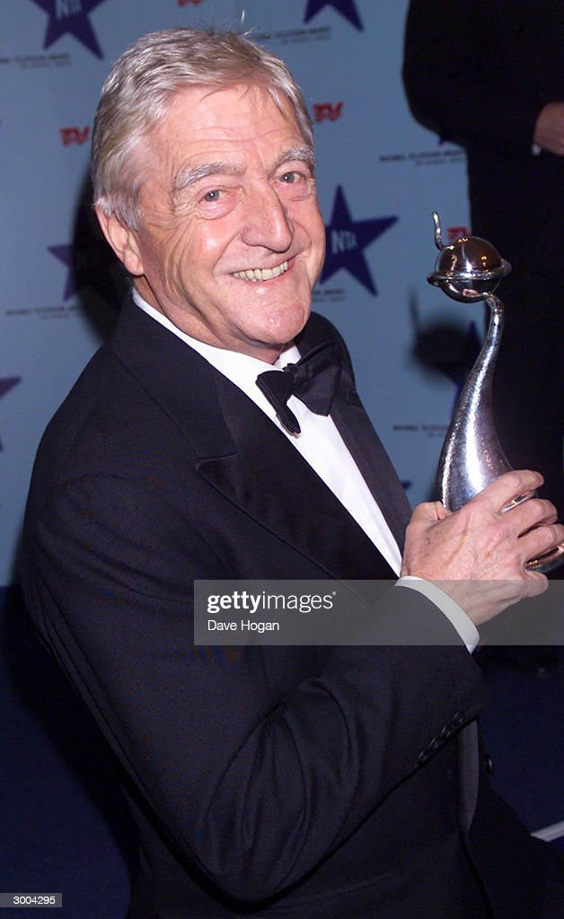 British television presenter Michael Parkinson arrives at the National Television Awards at the Royal Albert Hall on October 22, 2000 in London.