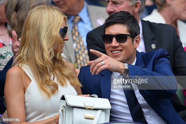 British television presenter Vernon Kay gestures in the royal box next to wife presenter and model Tess Daly as they prepare to watch US player...