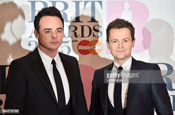 British television presenters Anthony McPartlin and Declan Donnelly known as Ant and Dec pose on the red carpet to attend the BRIT Awards 2015 in...