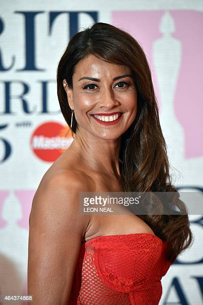 British television radio presenter and model Melanie Sykes poses on the red carpet to attend the BRIT Awards 2015 in London on February 25 2015...
