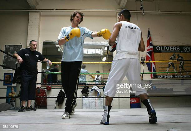 British tennis player Andrew Murray spars with British boxer Amir Khan at Olivers Gym on November 11 2005 in Salford England