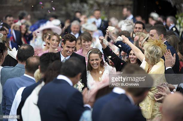 British tennis player Andy Murray and his new wife Kim Sears smile as they are showered in confetti after being married at Dunblane Cathedral on...