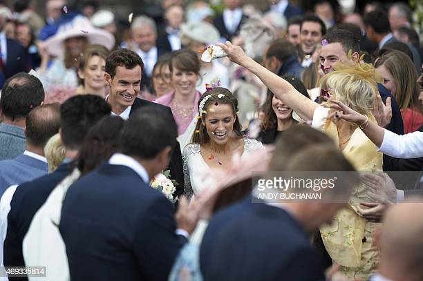 British tennis player Andy Murray and his new wife Kim Sears smile as they are showered in confetti on their wedding day at Dunblane Cathedral on...