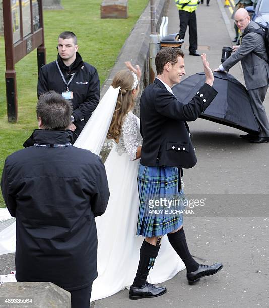 British tennis player Andy Murray and his new wife Kim Sears wave outside Dunblane Cathedral in Dunblane after being married on April 11 2015 Tennis...