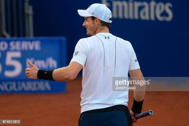 British tennis player Andy Murray gives a thumbs up during his match against Spanish tennis player Feliciano Lopez during the ATP Barcelona Open...