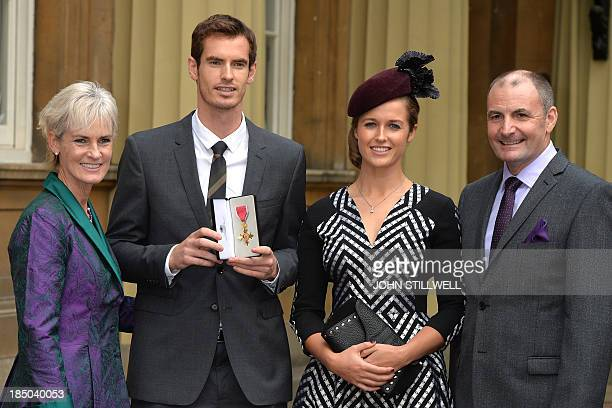 British tennis player Andy Murray poses for pictures with his girlfriend Kim Sears his mother Judy and father Will at Buckingham Palace in central...