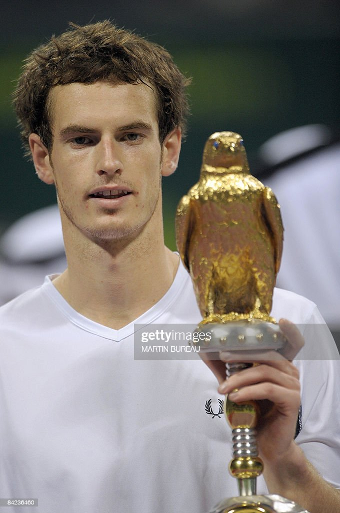 British tennis player Andy Murray poses with his trophy after winning the Qatar Tennis Open 2009 final against US Andy Roddick on January 10 2009 in...