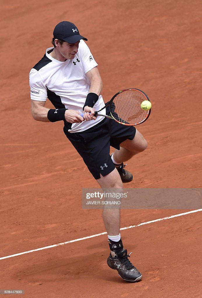 British tennis player Andy Murray returns a ball to French tennis player Gilles Simon during the Madrid Open tournament at the Caja Magica (Magic Box) sports complex in Madrid on May 5, 2016. / AFP / JAVIER
