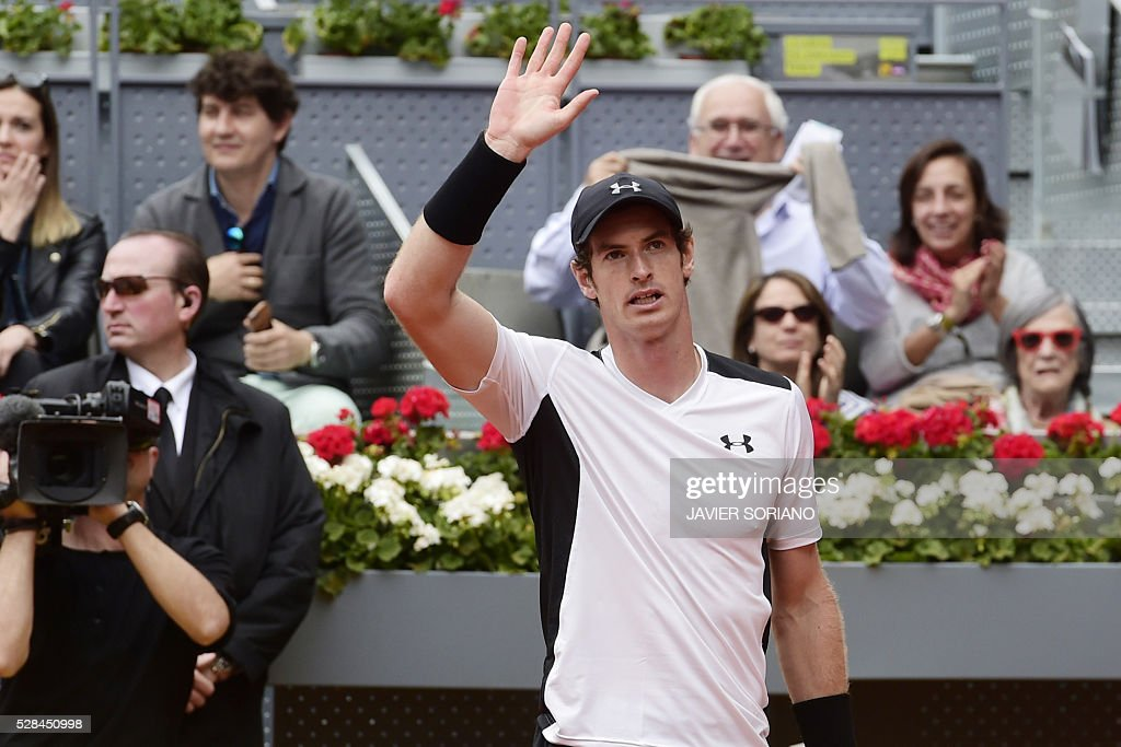 British tennis player Andy Murray waves after defeating French tennis player Gilles Simon during the Madrid Open tournament at the Caja Magica (Magic Box) sports complex in Madrid on May 5, 2016. / AFP / JAVIER