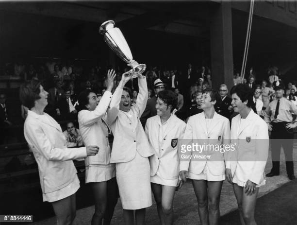British tennis player Angela Barrett nee Mortimer Captain of the triumphant British team holds aloft the Wightman Cup at Wimbledon UK 16th June 1968...