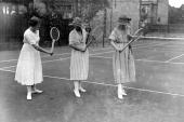British tennis player Dorothea Lambert Chambers showing two young women the backhand stroke at the opening of the Hampstead Tennis School