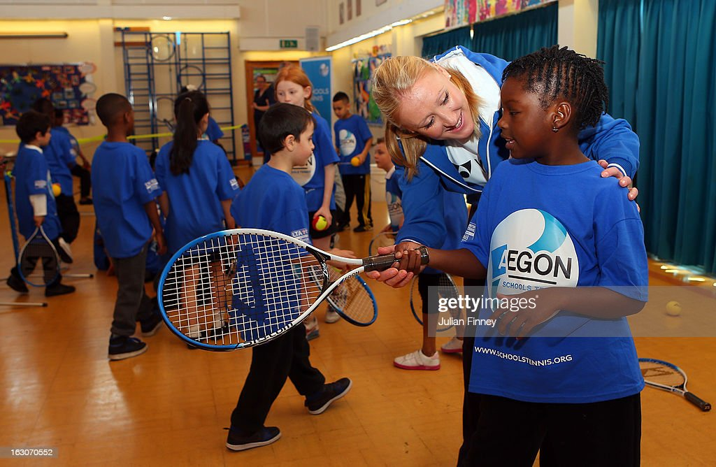 British tennis player <a gi-track='captionPersonalityLinkClicked' href=/galleries/search?phrase=Elena+Baltacha&family=editorial&specificpeople=210830 ng-click='$event.stopPropagation()'>Elena Baltacha</a> helps a child at the Britannia Village Primary School on March 4, 2013 in London, England. Aegon Schools Tennis Programme names Britannia Village Primary School, Newham as the 15,000th School beneficiary today which coincides with World Tennis Day.