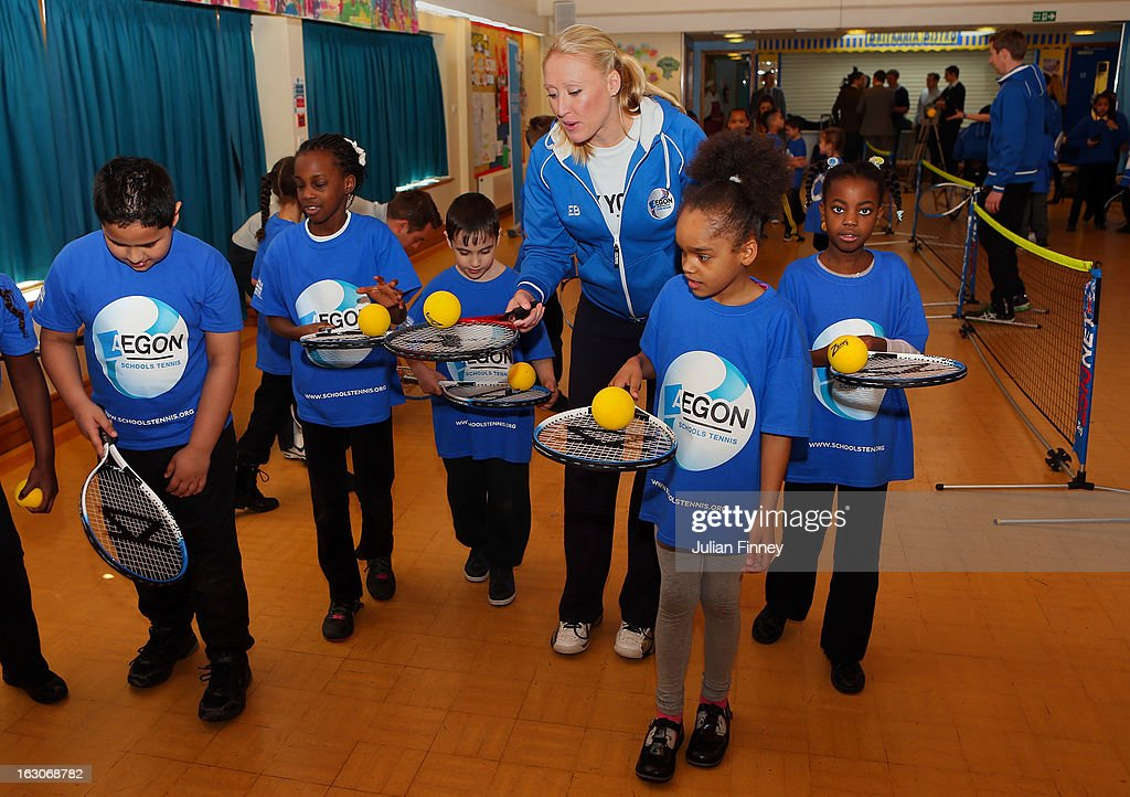 British tennis player <a gi-track='captionPersonalityLinkClicked' href=/galleries/search?phrase=Elena+Baltacha&family=editorial&specificpeople=210830 ng-click='$event.stopPropagation()'>Elena Baltacha</a> helps the children at the Britannia Village Primary School on March 4, 2013 in London, England. Aegon Schools Tennis Programme names Britannia Village Primary School, Newham as the 15,000th School beneficiary today which coincides with World Tennis Day.