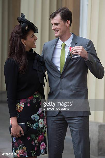 British tennis player Jamie Murray poses with his wife Alejandra Gutierrez at Buckingham Palace in London after he received his Officer of the Order...
