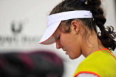 British tennis player Laura Robson appears dejected during the medal ceremony after the Singles Final of WTA Guangzhou Open on September 22 2012 in...