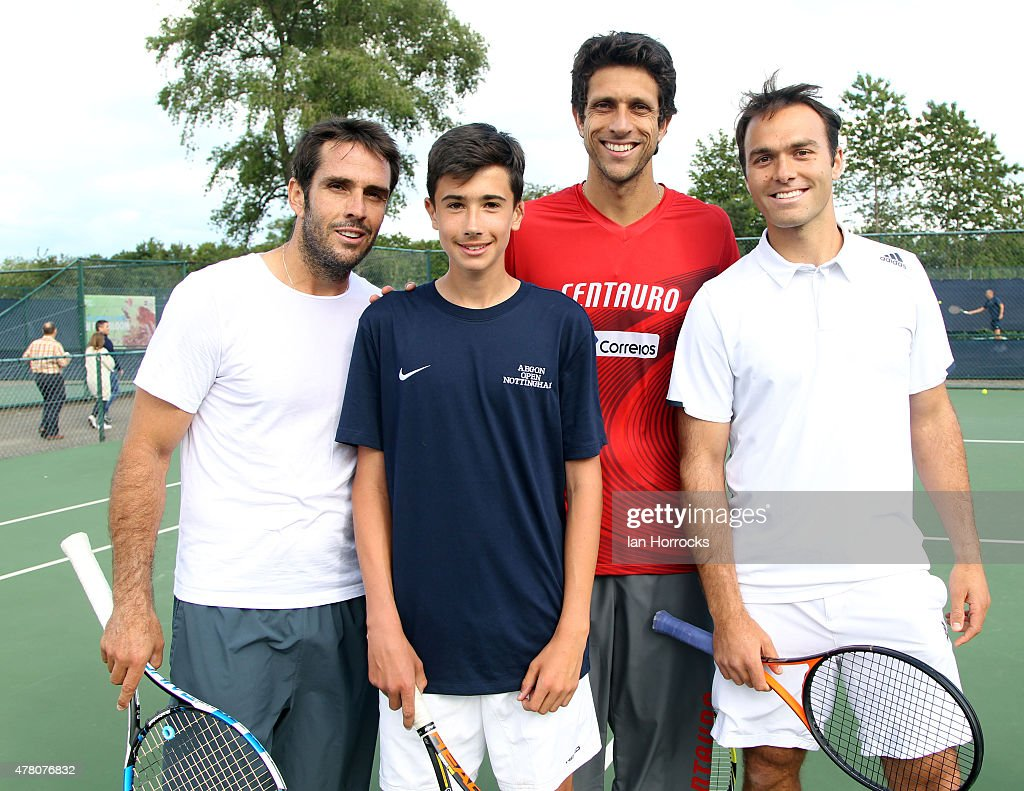 British tennis player Matthew Clegg of Yorkshire after a coaching session with Professional players <a gi-track='captionPersonalityLinkClicked' href=/galleries/search?phrase=David+Marrero&family=editorial&specificpeople=5357971 ng-click='$event.stopPropagation()'>David Marrero</a> of Spain (L) and <a gi-track='captionPersonalityLinkClicked' href=/galleries/search?phrase=Marcelo+Melo&family=editorial&specificpeople=4278628 ng-click='$event.stopPropagation()'>Marcelo Melo</a> of Brazil (C) with Ross Hutching of the LTA (R) during day one of the ATP Aegon Open at Nottingham Tennis Centre on June 21, 2015 in Nottingham, England.