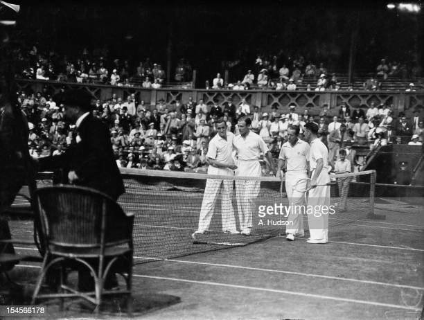 British tennis player Pat Hughes congratulates his doubles partner Raymond Tuckey after they beat Wilmer Allison and John Van Ryn of the USA in their...