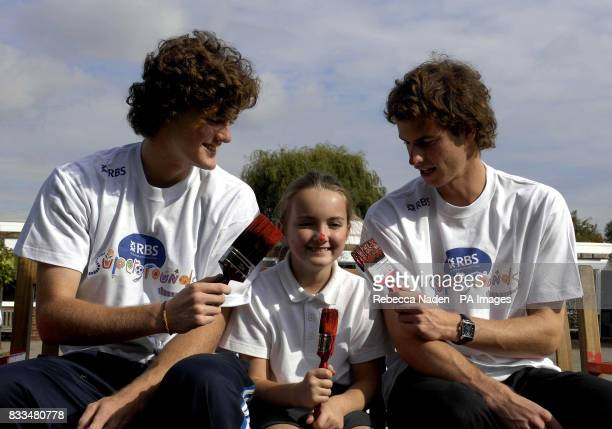 British tennis players Andy and Jamie Murray and pupil Rachael Wood at Dorchester Primary School Surrey